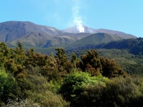 … smoke billowing from the mountain flanks ...