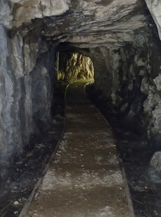 The rail tracks were leading the way through tunnels ...