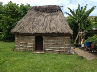Some of the villagers still live in traditional wooden huts without running water or electricity