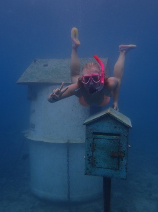 Bea trying to post a letter at the underwater post