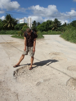 is this a pothole or a dinosaur footprint?