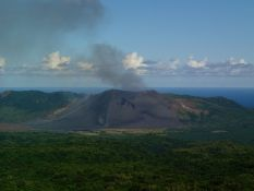 black Mount Yasur amidst the green jungle of Tanna