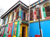 This beautifully coloured old merchant building sits in the centre of Little India where thousands of Indian workers were squeezing through tight shopping stalls on their free day.