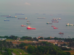 … with a sheer endless line of ships on the horizon waiting for unloading